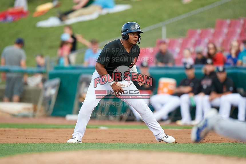 Kane County Cougars designated hitter Eudy Ramos (19) leads off first base during a game against the South Bend Cubs on July 21, 2018 at Northwestern Medicine Field in Geneva, Illinois.  South Bend defeated Kane County 4-2.  (Mike Janes/Four Seam Images)