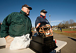 WATERTOWN, CT-112317JS02- Volunteers Stan Masayda and Don Stepanek greet fans as they stand near &quot;The Helmet&quot; prior to Watertown's Thanksgiving Day game against Torrington Thursday at Watertown High School. <br /> Jim Shannon Republican-American