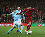 Gabriel Jesus of Manchester City  tackles Roberto Firmino of Liverpool during the Champions League Quarter Final 1st Leg, match at Anfield Stadium, Liverpool. Picture date: 4th April 2018. Picture credit should read: Simon Bellis/Sportimage