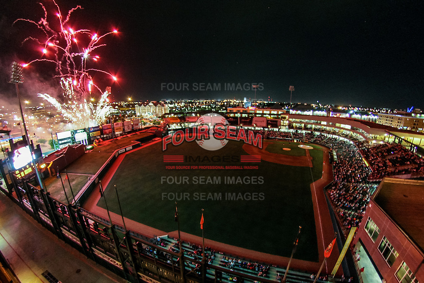 Fireworks light up the sky following the Pacific Coast League game between the Oklahoma City RedHawks and the Round Rock Express at Chickashaw Bricktown Ballpark on June 14, 2013 in Oklahoma City ,Oklahoma.  (William Purnell/Four Seam Images)