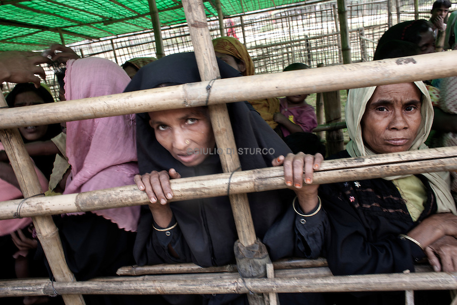 Rohingya refugees at the medical centre in Leda refugee camp, Cox's Bazar, Bangladesh. The Rohingya are a Muslim ethnic group originally from Myanmar (formerly Burma), many of who fled to Bangladesh as refugees (but also Pakistan, Saudi Arabia, the UAE, Thailand, Malaysia and Indonesia), following persecution and human rights violations under the ruling Burmese military junta. The UNHCR is currently working to repatriate them, however many are unable to return due to the Burmese regime, but also face problems in Bangladesh, where they do not receive governmental support.