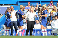 Chelsea Women's Manager, Emma Hayes has a chat with Sophie Ingle and Millie Bright while there is a break in the play during Chelsea Women vs Tottenham Hotspur Women, Barclays FA Women's Super League Football at Stamford Bridge on 8th September 2019