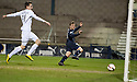Dundee's Jim McAlister (20) scores their second goal.