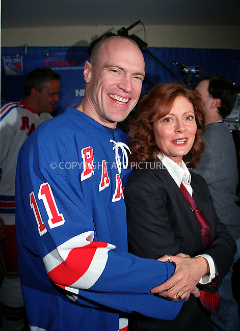 * WORLD SYNDICATION RIGHTS *  ..SUSAN SARANDON and NY Rangers captain MARK MESSIER at the Fourth Annual Superskate 2002 Charity Hockey Event at Madison Square Garden in New York. January 19, 2002.  © 2002 by Alecsey Boldeskul.  ONE-TIME REPRODUCTION RIGHTS.