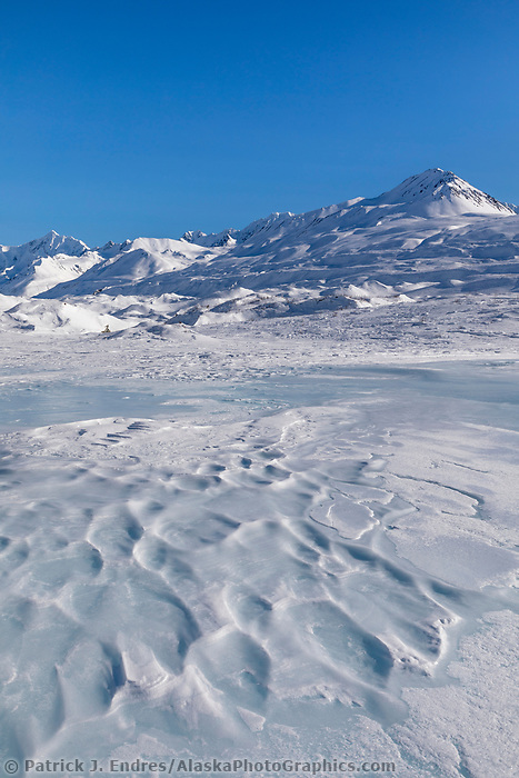 Winter landscape of overflow ice in the Alaska Range mountains, Interior, Alaska.