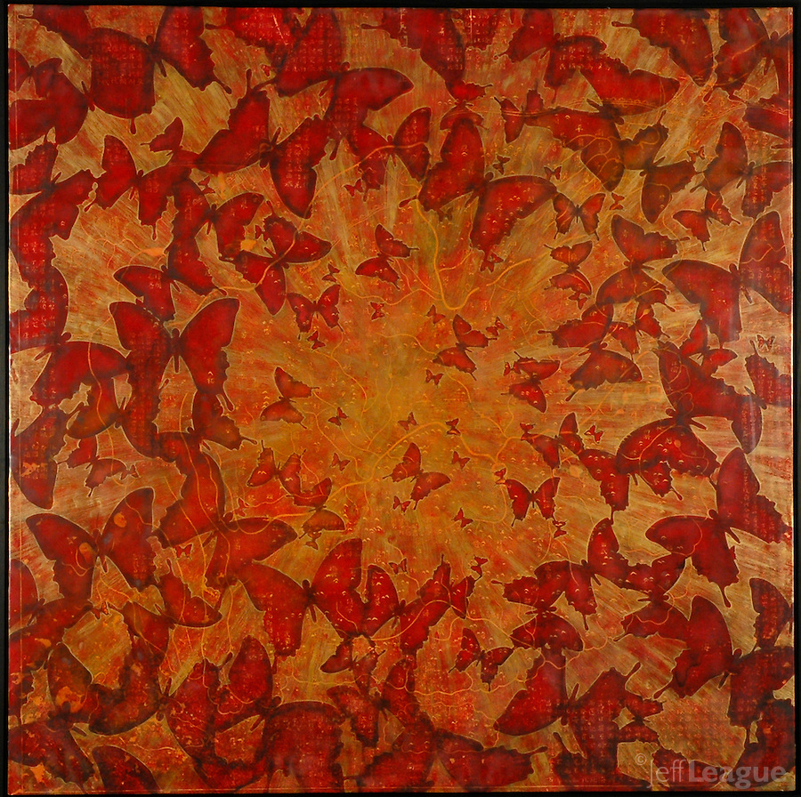 Butterflies resist encaustic photo painting in iridescent gold over red antique map of China.