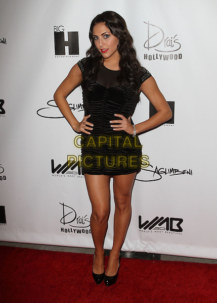 Cassie Scerbo.World's Most Beautiful Magazine Launch Event Held at Drai's At the W Hotel, Hollywood, California, USA..August 10th, 2011.full length black ruched dress hands on hips.CAP/ADM/KB.©Kevan Brooks/AdMedia/Capital Pictures.