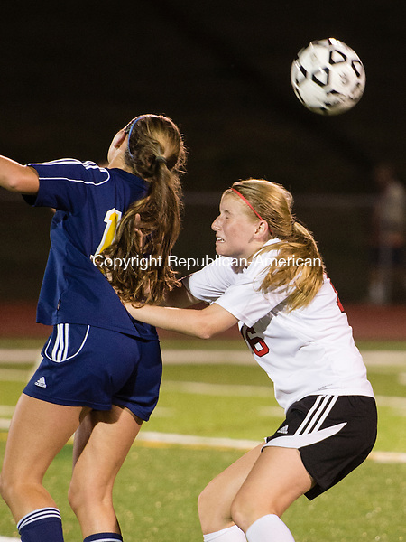 SOUTHBURY, CT - 24 September 2015-092415EC09-- Weston's Hannah Gluck and Pomperaug's Lindsey McCormack try to head the ball Thursday night in Southbury. Erin Covey Republican-American.