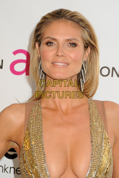 Heidi Klum .21st Annual Elton John Academy Awards Viewing Party held at West Hollywood Park, West Hollywood, California, USA..February 24th, 2013.oscars headshot portrait gold diamante sequins sequined silver earrings  plunging neckline cleavage .CAP/ADM/BP.©Byron Purvis/AdMedia/Capital Pictures.