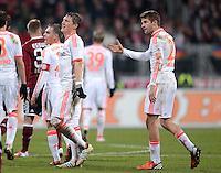 FUSSBALL   1. BUNDESLIGA  SAISON 2012/2013   12. Spieltag 1. FC Nuernberg - FC Bayern Muenchen      17.11.2012 Philipp Lahm, Bastian Schweinsteiger und Thomas Mueller (v. li. FC Bayern Muenchen)
