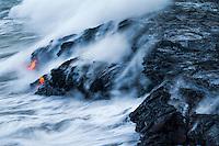 Glowing lava from Kilauea Volcano flows into the ocean off of Hilo, Big Island of Hawai'i.