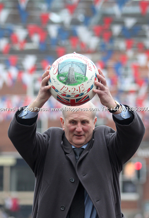 12/02/13 ..John Tomkinson holds up the first ball before turning up (kicking-off) the annual Royal Shrovetide Football match in Ashbourne, Derbyshire. ..Shrovetide Football is played every Shrove Tuesday and Ash Wednesday. Unlike a conventional football match this game is played over two eight hour periods, the goals are three miles apart and there are very few rules...The leather ball which has a cork inner is 'turned up' from a stone plinth on Shaw Croft car park in Ashbourne town centre. The ball is thrown into the air and into the 'hug', a large group of players who try to move the ball to their goal by pushing against the opposition...Your team depends on which side of the Henmore brooke you were born on, those born on the South are Down'ards and try to goal the ball at the old Clifton Mill. Those born on the North are Up'ards and try to goal the ball at the old Sturston Mill...All Rights Reserved - F Stop Press.  www.fstoppress.com. Tel: +44 (0)1335 300098.