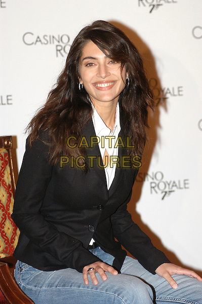 "CATERINA MURINO.Photocall for ""Casino Royale"" at Murino Hotel, St Regis, Rome, Italy..December 14th, 2006.half length black suit jacket .CAP/CAV.©Luca Cavallari/Capital Pictures"