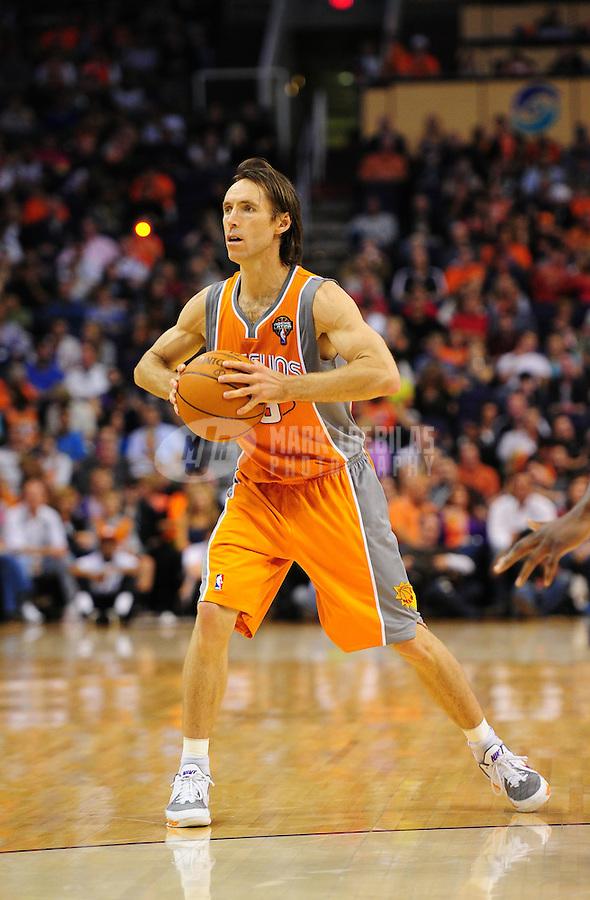 Mar. 25, 2011; Phoenix, AZ, USA; Phoenix Suns guard (13) Steve Nash against the New Orleans Hornets at the US Airways Center. The Hornets defeated the Suns 106-100. Mandatory Credit: Mark J. Rebilas-.