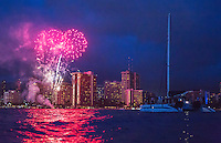 Fireworks over Hilton Hawaiian Village from the ocean near a catamaran cruise, Waikiki, Oahu