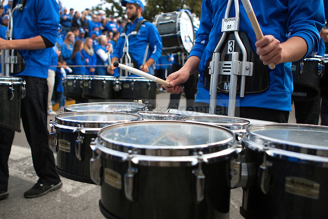 The Wildcat Marching Band walks through the Cat Walk prior to the game between the Kentucky Wildcats and the Mississippi State Bulldogs at Commonwealth Stadium on Saturday, October 25, 2014 in Lexington, Ky. Photo by Michael Reaves | Staff