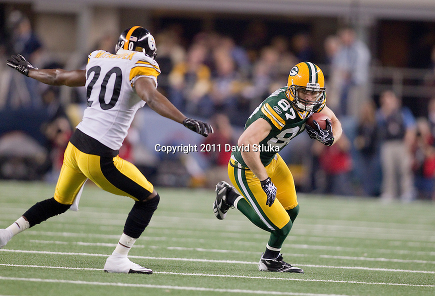 Pittsburgh Steelers defensive back Bryant McFadden (20) pursues Green Bay Packers wide receiver Jordy Nelson (87) during Super Bowl XLV on Sunday, February 6, 2011, in Arlington, Texas. The Packers won 31-25. (AP Photo/David Stluka)