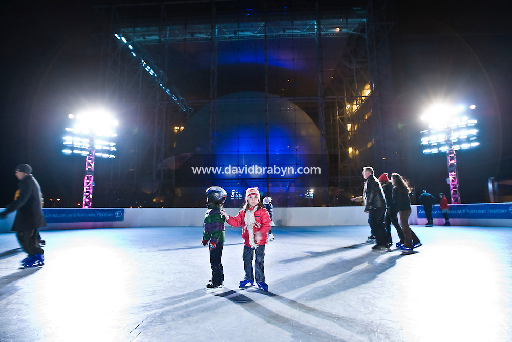 People skate on the new Polar rink at the American Museum of Natural History in New York, NY, United States, 19 November 2008. The rink, made from synthetic ice, is overlooked by the 87-foot Hayden Sphere in Rose Center for Earth and Space.