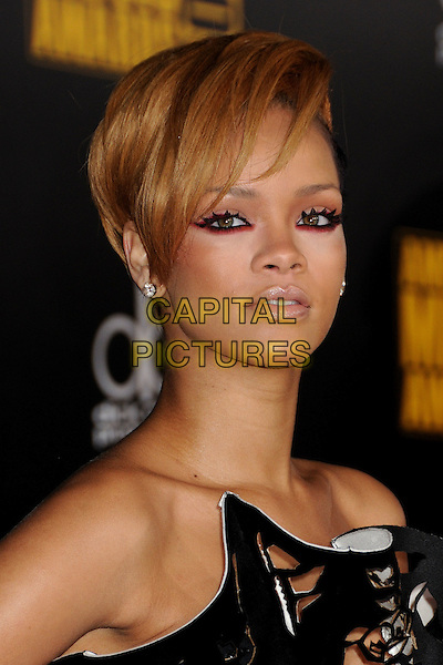 RIHANNA (Robyn Rihanna Fenty).The 2009 American Music Awards held at The Nokia Theatre L.A. Live in Los Angeles, California, USA. .November 22nd, 2009.AMA AMA's headshot portrait eyeliner eyeshadow pink make-up black white strapless cut out away perforated floral print .CAP/ADM/BP.©Byron Purvis/AdMedia/Capital Pictures.
