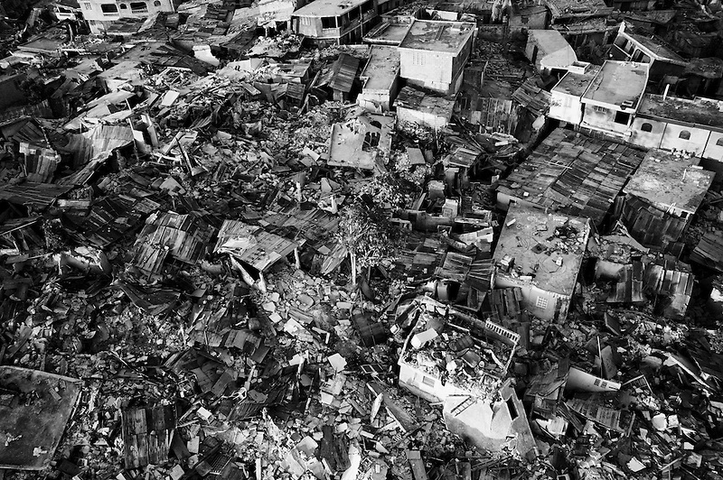 Port Au Prince, Haiti, Jan 27 2010.The Fort National neighborhood is entirely destroyed. Seen from the sky, Port au Prince two weeks after the earthquake; a large majority of buildings are either destroyed or too damaged to be used, so most inhabitants sleep out, in the street near their home or in makeshift camps..
