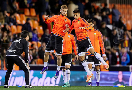 06.03.2016. Mestalla Stadium, Valencia, Spain. La Liga match between Valencia versus Atletico Madrid. Defender Shkodran Mustafa of Valencia CF (L) and Defender Joao Cancelo of Valencia CF warm up prior to the game