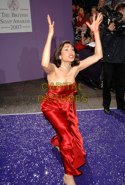 GUEST.Arrivals at the British Soap Awards 2007,.BBC Television Centre, London, England, .May 26, 2007..full length red dress funny arms hands.CAP/PL.©Phil Loftus/Capital Pictures