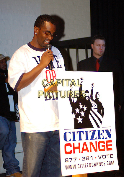 "P.DIDDY AKA SEAN COMBS.Speaks at the ""Citizen Change - Vote or Die!"" event at Club Empire,  Pittsburgh, PA, USA, October 27th 2004. .half length diamond earrings Puffy Puff Daddy sunglasses slogan t-shirt t shirt  P Diddy.**UK SALES ONLY**.Ref:ADM.www.capitalpictures.com.sales@capitalpictures.com.©JN/AdMedia/Capital Pictures ."