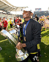 Emmanuel Ekpo carries the MLS Cup trophy during MLS Cup 2008. Columbus Crew defeated the New York Red Bulls, 3-1, Sunday, November 23, 2008. Photo by John Todd/isiphotos.com