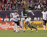 Portland Timbers midfielder James Marcelin (14) dribbles as New England Revolution midfielder Pat Phelan (28) defends. In a Major League Soccer (MLS) match, the New England Revolution tied the Portland Timbers, 1-1, at Gillette Stadium on April 2, 2011.