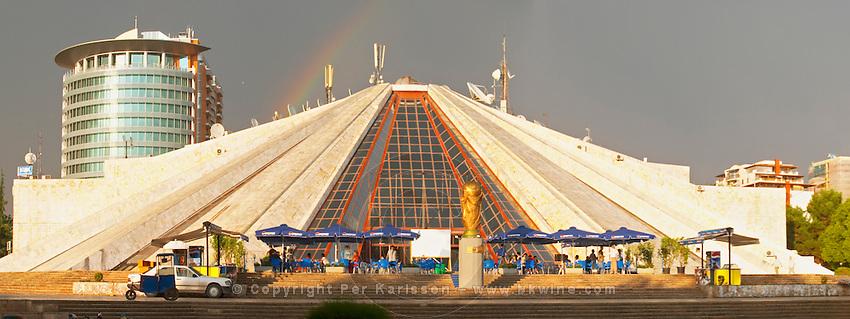The monument mausoleum museum of the former dictator Enver Hoxa Hoxha, in pyramid shape. ray of sunshine, rainbow in the sky. Panorama. Tirana capital. Albania, Balkan, Europe.