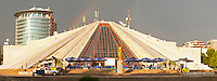 The monument mausoleum museum of the former dictator Enver Hoxa Hoxha, in pyramid shape. ray of sunshine, rainbow in the sky. Panorama. Tirana capital. Albania, Balkan, Europe.