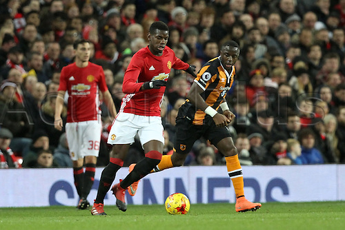 10.01.2017.  Old Trafford, Manchester, Lancashire, England. EFL Cup semi-final 1st leg, Manchester United versus Hull FC. Paul Pogba of Manchester United is tracked by Abel Hernandez of Hull City.