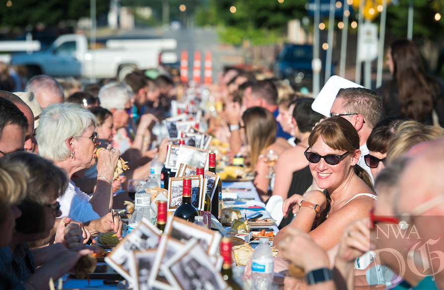 NWA Democrat-Gazette/CHARLIE KAIJO Guests enjoy a dinner a dinner and each other's company, Saturday, June 9, 2018 on Emma Ave. in Springdale. <br /><br />Back for its 3rd year, this popular event brought hundreds of guests together for a lively, friendly community dinner of multiple courses served under the night sky—right down the middle of Emma Avenue. Past attendees raved about the special experience of dining al fresco with family and friends, as well as meeting new neighbors.