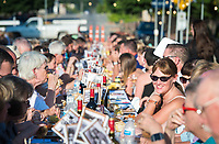 NWA Democrat-Gazette/CHARLIE KAIJO Guests enjoy a dinner a dinner and each other's company, Saturday, June 9, 2018 on Emma Ave. in Springdale. <br /><br />Back for its 3rd year, this popular event brought hundreds of guests together for a lively, friendly community dinner of multiple courses served under the night sky&acirc;&euro;&rdquo;right down the middle of Emma Avenue. Past attendees raved about the special experience of dining al fresco with family and friends, as well as meeting new neighbors.