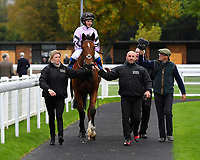 Winner of The Byerley Stud 'Season Finale' Handicap, Moabit ridden by Megan Nicholls and trained by Paul Nicholls is led into the winners enclosure during Bathwick Tyres Reduced Admission Race Day at Salisbury Racecourse on 9th October 2017