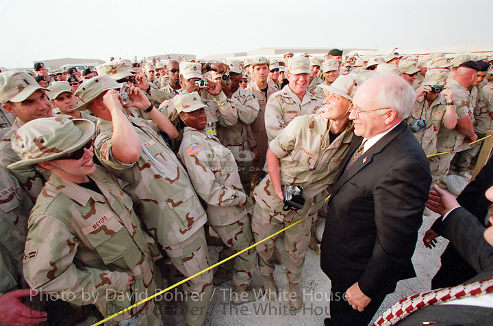 Vice President Cheney: 4pm: Arrival, tour, and visit to troops at Al Uldeid Air Base and Camp Andy.  Doha, Qatar.  .Used for Photos of Note March 17 - 18, 2002.   PON.Troops at Al-Udeid Airbase in Qatar gather around Vice President Dick Cheney for pictures and handshakes March 17, 2002. Requested by American Legeslative Exchange Council..Released to the NRSC.Released to Esquire Magazine 9.1.04..Released to NIGHTLINE 111203. .ordered as jumbo for RNC 070403 .Used in OVP 2002 Christmas Slide Show.WEB .WEST WING JUMBO .WEB..RESCAN