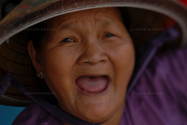 An old woman smiles in Hoi An, Vietnam.