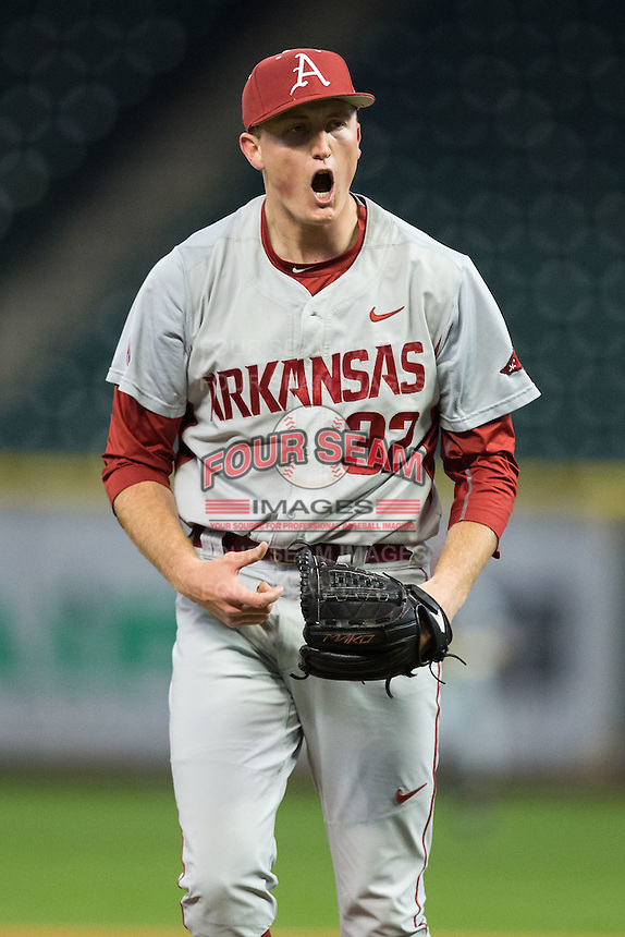 Arkansas Razorbacks relief pitcher Zach Jackson (32) reacts after getting the final out in the 8th inning against the Rice Owls in game three of the 2016 Shriners Hospitals for Children College Classic at Minute Maid Park on February 26, 2016 in Houston, Texas.  The Razorbacks defeated the Owls 5-2.  (Brian Westerholt/Four Seam Images)