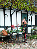 Lena Brandsten making Christmas wreathes in her garden in Skåne