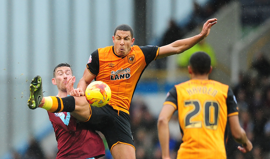 Burnley's David Jones vies for possession with Hull City's Jake Livermore<br /> <br /> Photographer Chris Vaughan/CameraSport<br /> <br /> Football - The Football League Sky Bet Championship - Burnley v Hull City - Saturday 6th February 2016 - Turf Moor - Burnley <br /> <br /> &copy; CameraSport - 43 Linden Ave. Countesthorpe. Leicester. England. LE8 5PG - Tel: +44 (0) 116 277 4147 - admin@camerasport.com - www.camerasport.com
