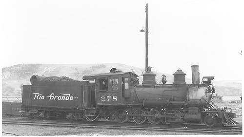 Engineer's-side view of C-16 #278 by ash pit in Gunnison.<br /> D&amp;RGW  Gunnison, CO  Taken by Maxwell, John W. - 6/1/1947