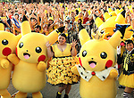 "August 12, 2016, Yokohama, Japan - Japanese actress and comedienne Naomi Watabe (C) smiles with Pikachu characters, Nintendo's videogame software Pokemon's wellknown character, after she and Pikachu performed dancing at a show ""Super Soaking Splash Show"" in Yokohama, suburban Tokyo on Friday, August 12, 2016. The Pikachu mascots perfom the several shows daily to attract summer vacationers as a part of the ""Great Pikachu Outbreak"" event through August 14.    (Photo by Yoshio Tsunoda/AFLO) LWX -ytd-"