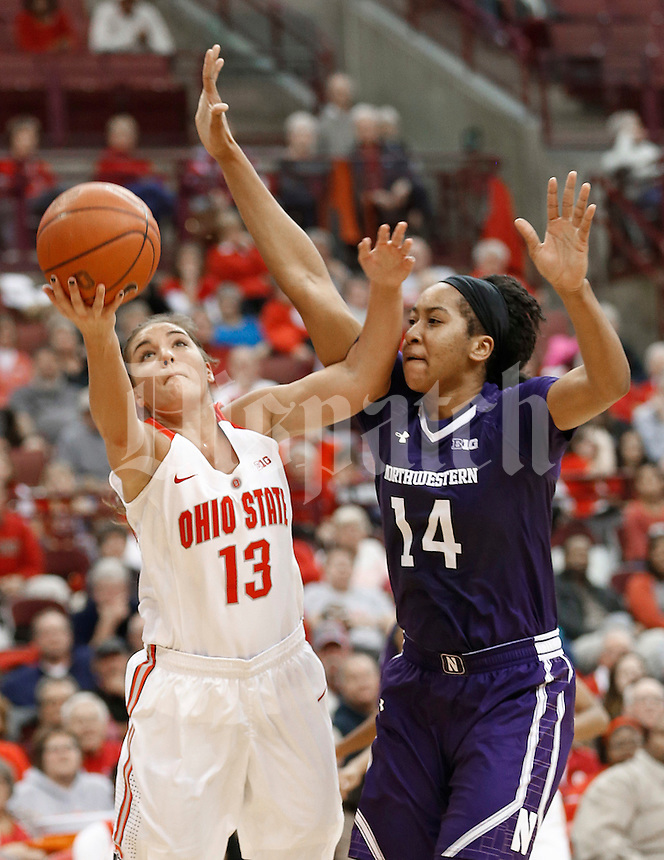 Ohio State Buckeyes guard Cait Craft (13) goes up for two and is fouled by Northwestern Wildcats forward Pallas Kunaiyi-Akpanah (14) late in the second half at Value City Arena on January 28, 2016.  (Chris Russell/Dispatch Photo)