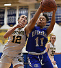 Danielle Pavinelli #12 of Northport, left, puts defensive pressure on Ishanti Gumbs #11 of Riverhead during a Suffolk County League II girls basketball game at Northport High School on Friday, Dec. 14, 2018. Pavinelli recorded 11 points and five assists in Northport's 48-21 win.
