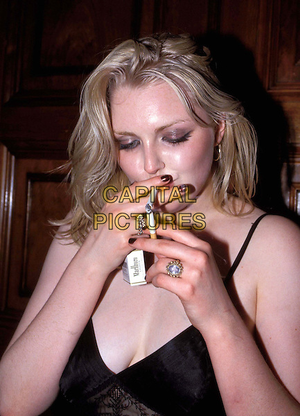 SOPHIE DAHL.Ref:4906 .large model, cleavage, smoking marlboro cigarette, half length, half-length.www.capitalpictures.com.sales@capitalpictures.com.© Capital Pictures