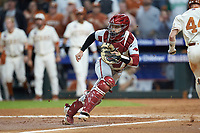 Arkansas Razorbacks catcher Casey Opitz (12) on defense against the Texas Longhorns in game six of the 2020 Shriners Hospitals for Children College Classic at Minute Maid Park on February 28, 2020 in Houston, Texas. The Longhorns defeated the Razorbacks 8-7. (Brian Westerholt/Four Seam Images)