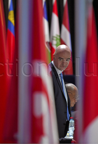 26.02.2016. Zurich, Switzerland. UEFA Secretary-General Gianni Infantino Switzerland looks therough The Series of the Country flags on the stage