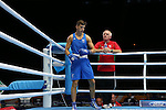 Glasgow 2014 Commonwealth Games<br /> Men's Light Welter (64kg)<br /> Zack Davies, Wales (Blue) v Waheed Shogbamu, Nigeria (Red)<br /> Coach Colin Jones looks on.<br /> 27.07.14<br /> &copy;Steve Pope-SPORTINGWALES
