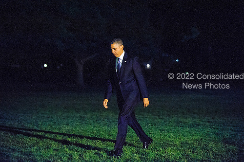 United States President Barack Obama walks across the South Lawn of the White House after arriving aboard Marine One in Washington, D.C., U.S., on Monday, May.13, 2013. The President was returning from New York City where he attended two DNC events at private residences and a joint DCCC/DSCC event at the Waldorf Astoria Hotel. <br /> Credit: Pete Marovich / Pool via CNP