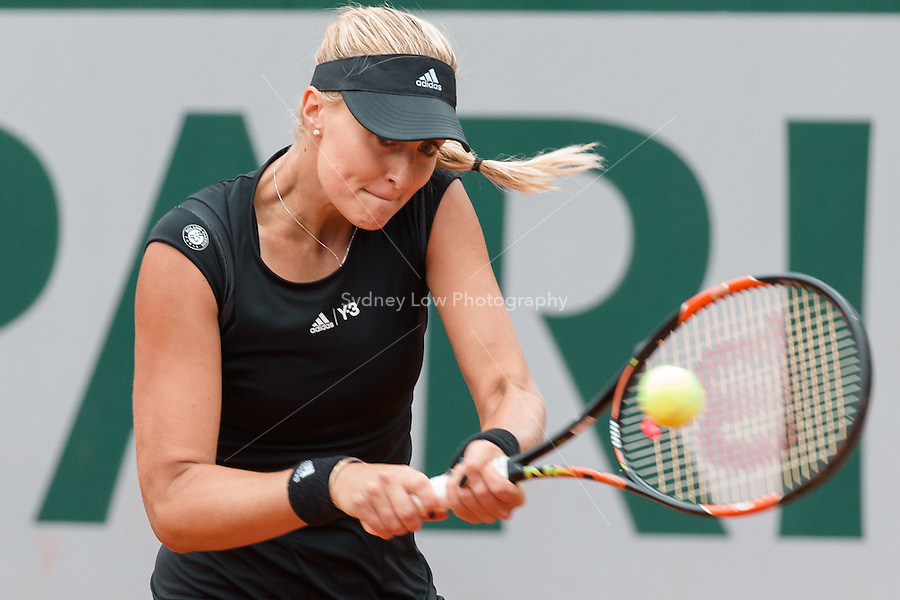 May 26, 2015: Kristina Mladenovic (FRA) in action in a 1st round match against Eugenie Bouchard (CAN) on day three of the 2015 French Open tennis tournament at Roland Garros in Paris, France. Mladenovic won 64 64. Sydney Low/AsteriskImages